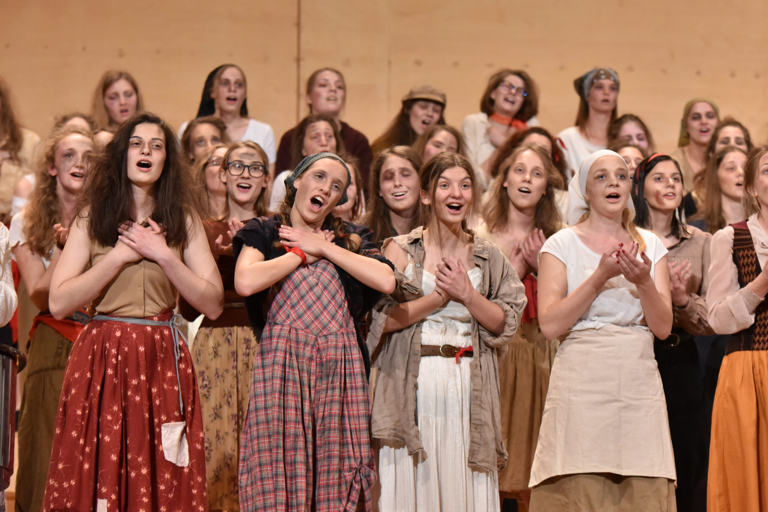Janez Eržen, Slovenia: Les Misérables, 2019, (Re)Mixed Choir of the Diocesan Classical Gymnasium, Slovenia  - A scene from the musical Les Misérables. A fine example of costume design that upgrades the message of the performance.