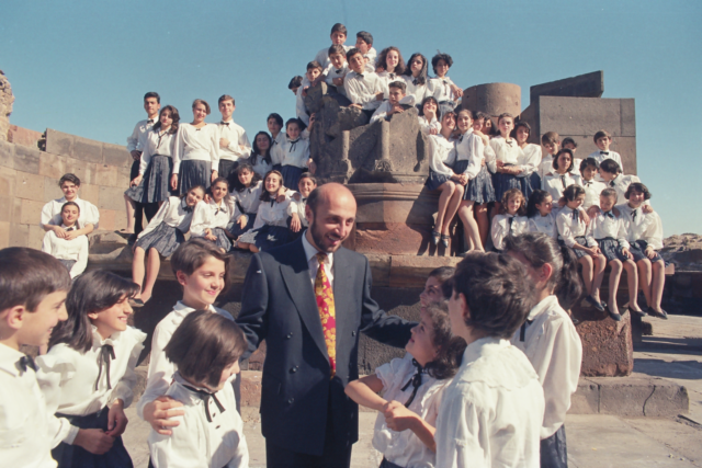 """Poghos Poghosyan, Armenia: Little Singers of Armenia, 1994, Zvartnots Historical-Cultural Museum-Reservation, Armenia - The choir's first photograph. The choir should have had a worldwide concert tour entitled """"Peace to the World"""" dedicated to the 50th anniversary of the United Nations. For the publicity of the event, the choir organised a photoshoot in Zvartnots Historical-Cultural Museum-Reservation."""