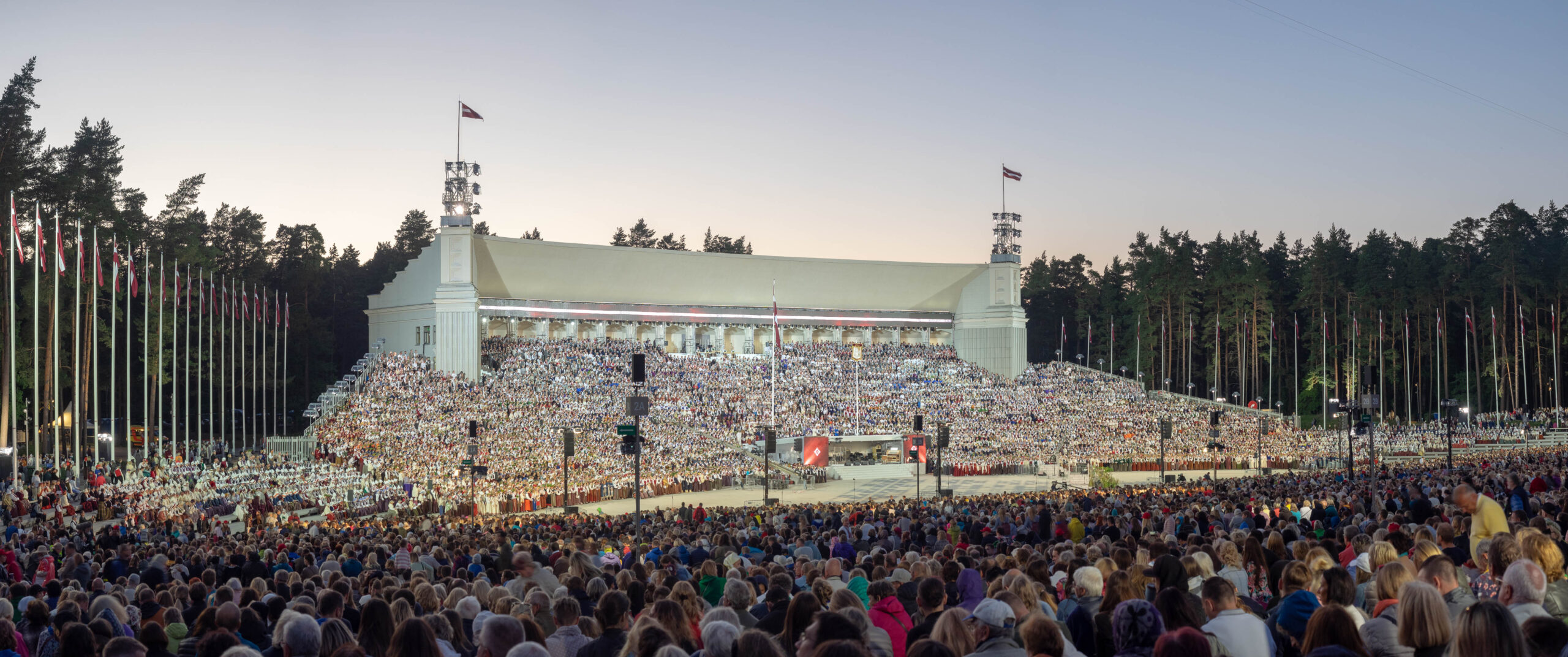"""Valdis Ošiņš, Latvia: Final Concert, 2018, United Choir of 12,000 singers at the Latvian Song and Dance Festival, Latvia - """"Dziesmu svētki"""" is a jewel of Latvian culture since 1873. Tens of thousands of people sing and dance once every five years, watched by national and global audiences. It has been added to the UNESCO List of the Intangible Cultural Heritage of Humanity together with a similar Estonian and Lithuanian festival, as Baltic song and dance celebrations."""
